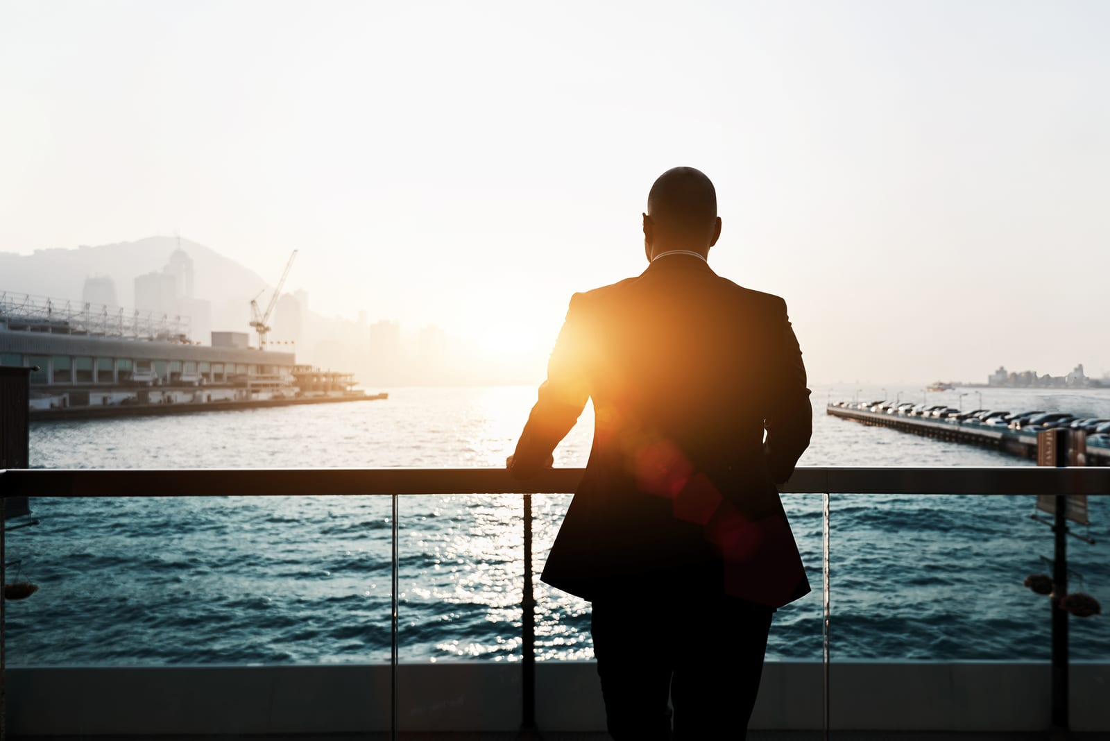 Silhouette of male skilled and confident businessman is thinking