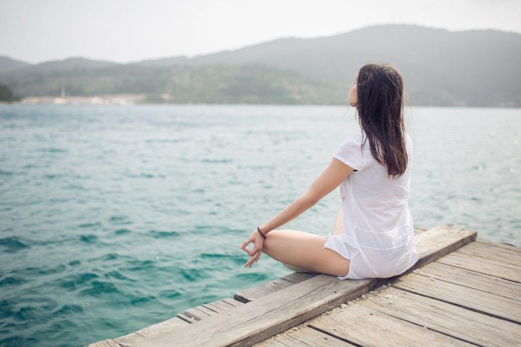 Woman meditating in sitting yoga position