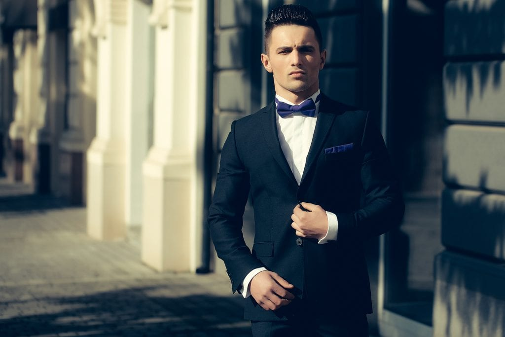 Confident looking young man wearing a nice looking suit